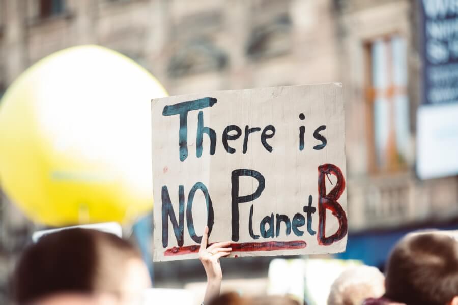 Klimata pārmaiņu protesta plakāts
